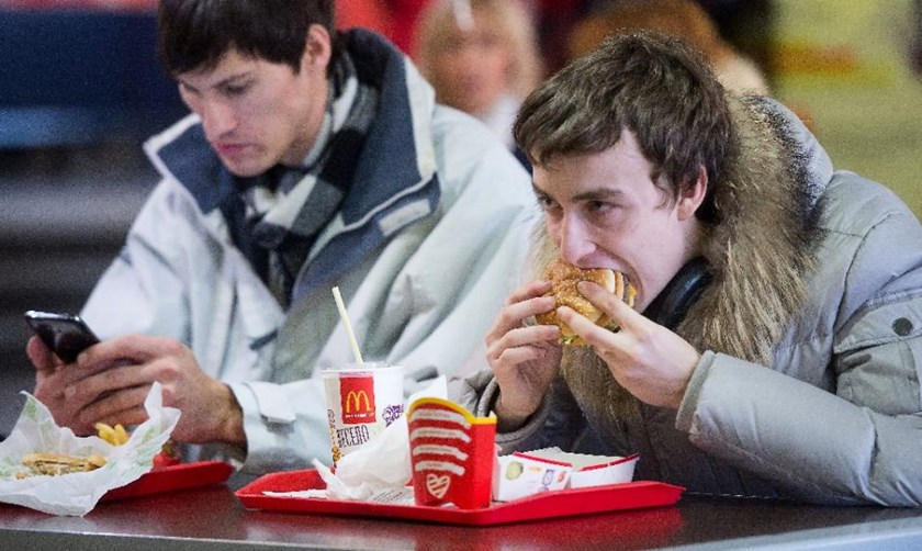 People eat in a McDonald's restaurant in Moscow on November 19, 2014