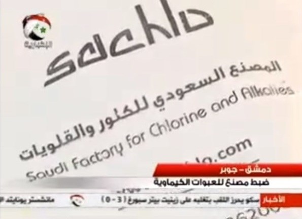 Syrian TV news report showing chemical agents seized in rebels' stronghold, identified as manufactured in Saudi Arabia