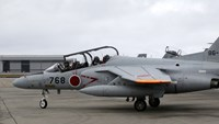 A two-seater T-4 training aircraft readies for take-off at Naha Self-Defense Force Base in Okinawa, Japan.