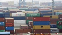 A trailer loaded with container boxes travels in Ningbo port in Zhejiang province, January 22, 2015.