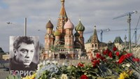 A portrait of Kremlin critic Boris Nemtsov and flowers are pictured at the site where he was killed on February 27, with St. Basil's Cathedral seen in the background, at the Great Moskvoretsky Bridge in central Moscow March 6, 2015.