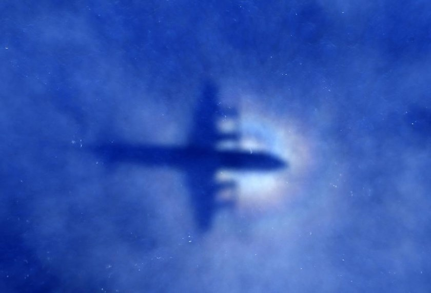 The shadow of a Royal New Zealand Air Force (RNZAF) P3 Orion maritime search aircraft can be seen on low-level clouds as it flies over the southern Indian Ocean looking for missing Malaysian Airlines flight MH370 March 31, 2014.