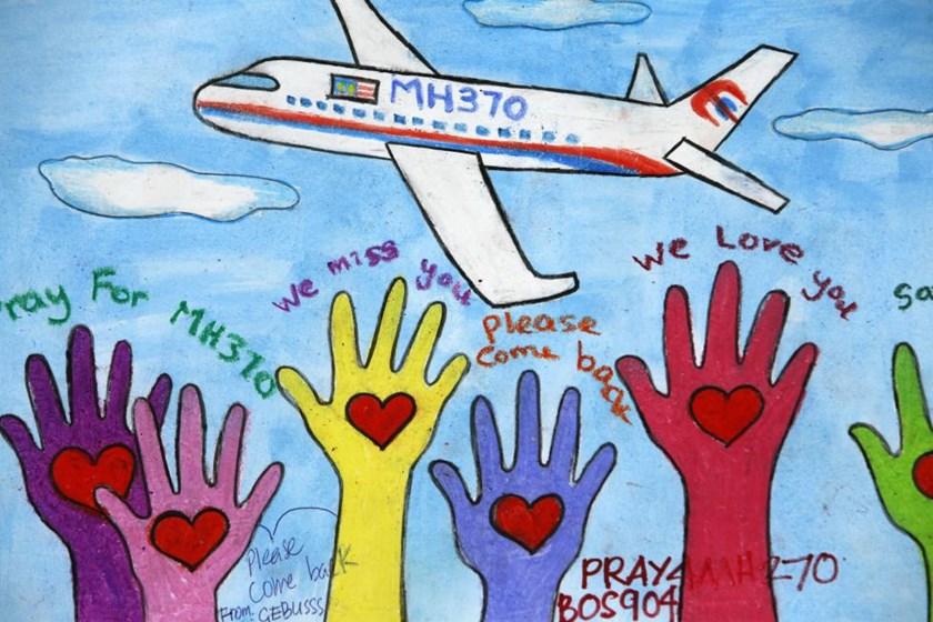 An artwork conveying well-wishes for the passengers and crew of MH370 is seen at a viewing gallery in Kuala Lumpur International Airport March 19, 2014.