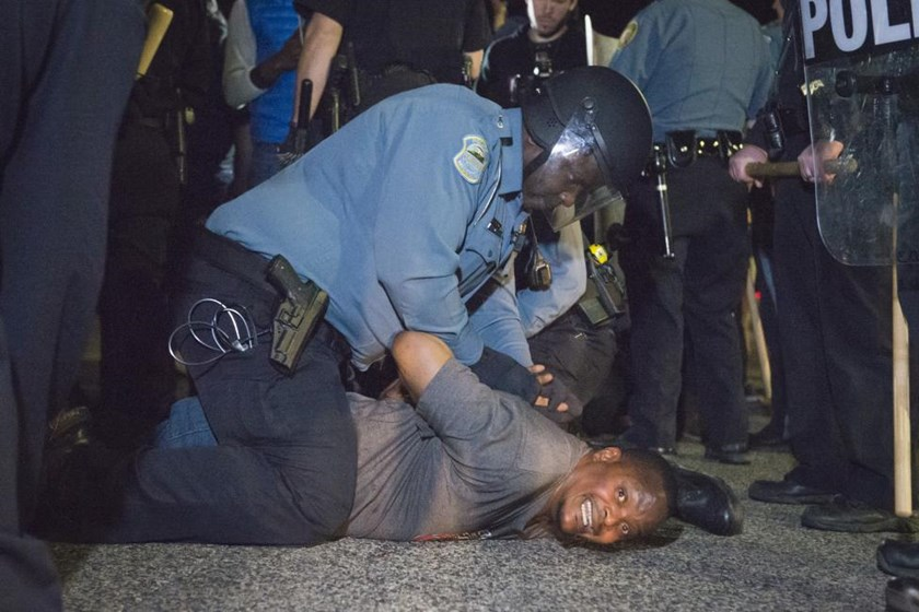 Police arrests a protestor outside the City of Ferguson Police Department and Municipal Court in Ferguson, Missouri, March 11, 2015.
