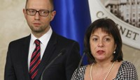 Ukraine's Finance Minister Natalia Yaresko and Prime Minister Arseny Yatseniuk address the media during a news briefing in Kiev March 11, 2015.