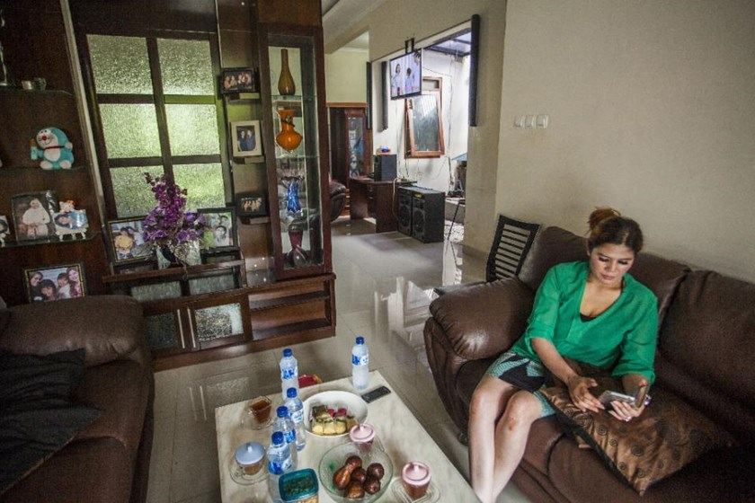 40 year-old Wina Lia poses inside her home in Sleman on March 11, 2015
