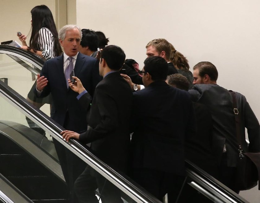 Foreign Relations Committee Chairman Bob Corker, who did not sign the letter sent to Iran, is followed up an escalator by reporters on March 10, 2015 in Washington, DC