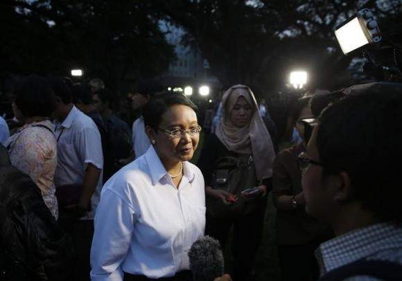 Retno Marsudi speaks to the media after she was named the country's next foreign minister at the presidential palace in Jakarta October 26, 2014.