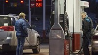 People get gasoline at a Conoco station in St. Louis, Missouri January 14, 2015.