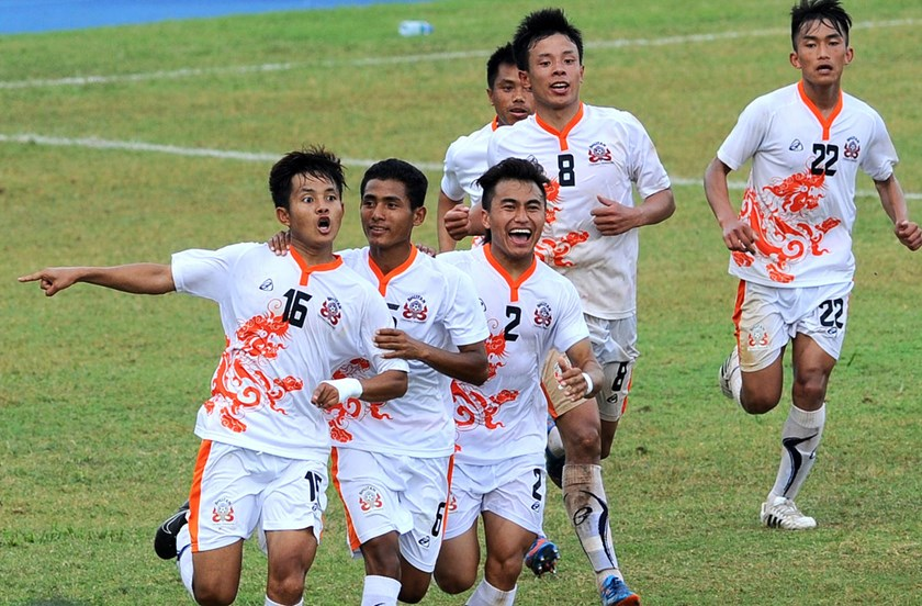 Bhutanese football player Tshering Dorji, left, celebrates after scoring a goal during the 2018 FIFA World Cup football qualifying match between Sri Lanka and Bhutan at the Sugathadasa Stadium in Colombo on March 12, 2015.