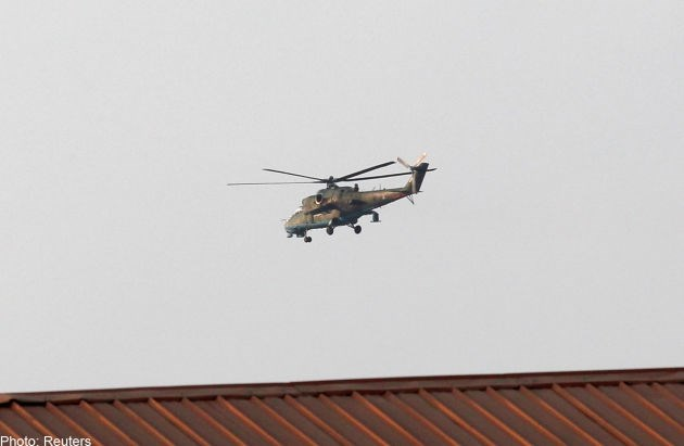 A military helicopter is seen flying in Lashio on February 19, 2015, in Myanmar's northeastern Shan state