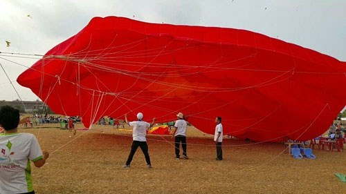 The kite, which spans 18 meters, belongs the Saigon Kite Club