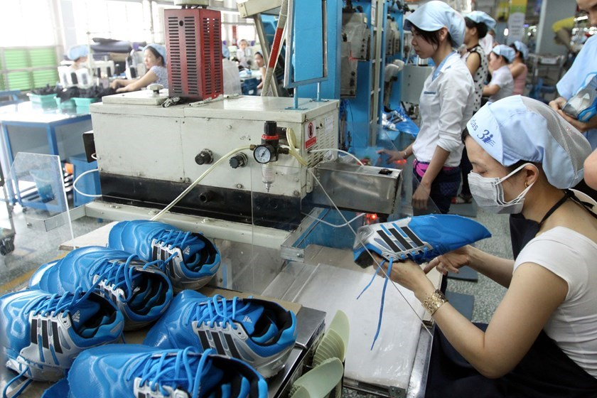 Workers at a Adidas plant in central Vietnam