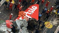 The tail of AirAsia QZ8501 passenger plane is seen on the deck of the Indonesian Search and Rescue (BASARNAS) ship Crest Onyx after it was lifted from the sea bed, south of Pangkalan Bun, Central Kalimantan in this January 10, 2015 file photo.