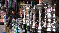 A Pakistani shopkeeper waits for customers at his traditional Sheesha shop in Karachi.