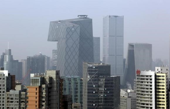 The China Central Television (CCTV) Headquarters (tallest building on L) and other office buildings are pictured in Beijing's central business district, January 20, 2015.