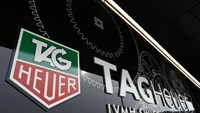 The Tag Heuer logo is seen at the entrance of their new watch manufactory in Chevenez November 5, 2013.