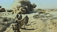 Dust rises after an improvised explosive device is detonated during an operation by the U.S. Army during a patrol in the village of Naja-bien, Afghanistan in September 2012.