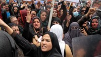 Afghan protesters shout slogans during a rally in front of the Supreme Court in Kabul, Afghanistan, March, 24.