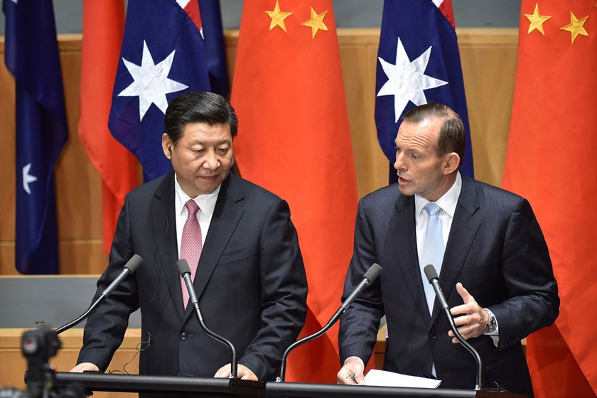 Tony Abbott, Australia's Prime Minister, right, speaks as Xi Jinping, China's president, looks on while delivering a statement at Parliament House in Canberra, Australia, on Nov. 17, 2014.