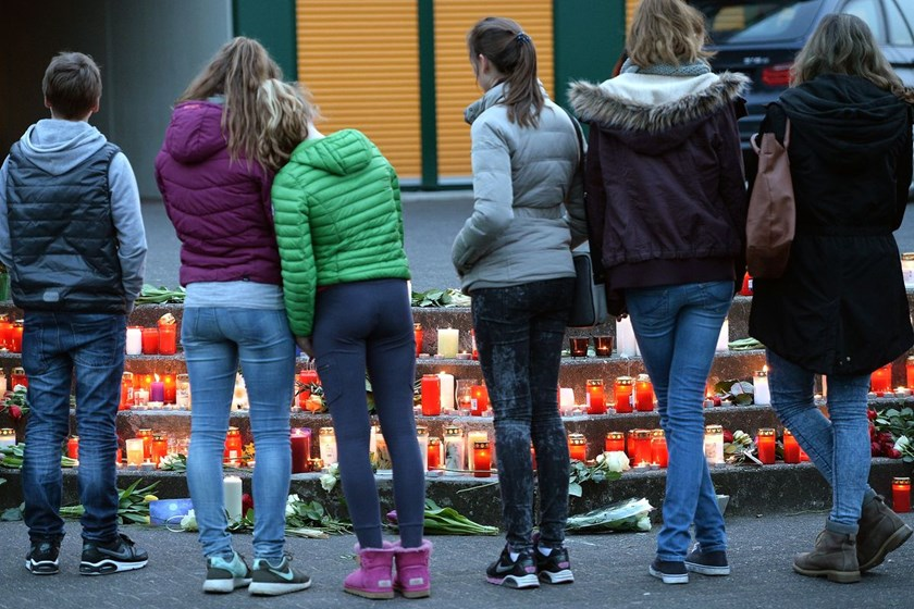 Students and well wishers gather in front of the Joseph-Koenig-Gymnasium secondary school in Haltern am See, Germany on March 24, 2015, from where some of the Germanwings plane crash victims came.
