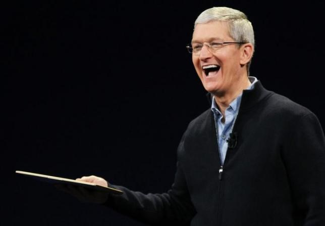 Apple CEO Tim Cook shows the new MacBook during an Apple event in San Francisco, California March 9, 2015.