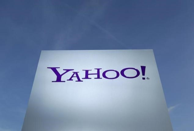 A Yahoo logo is pictured in front of a building in Rolle, 30 km (19 miles) east of Geneva, in this file picture taken December 12, 2012.