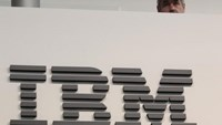 A worker is pictured behind a logo at the IBM stand on the CeBIT computer fair in Hanover February 26, 2011. The world's largest IT fair CeBIT opens its doors on March 1 and runs through March 5.