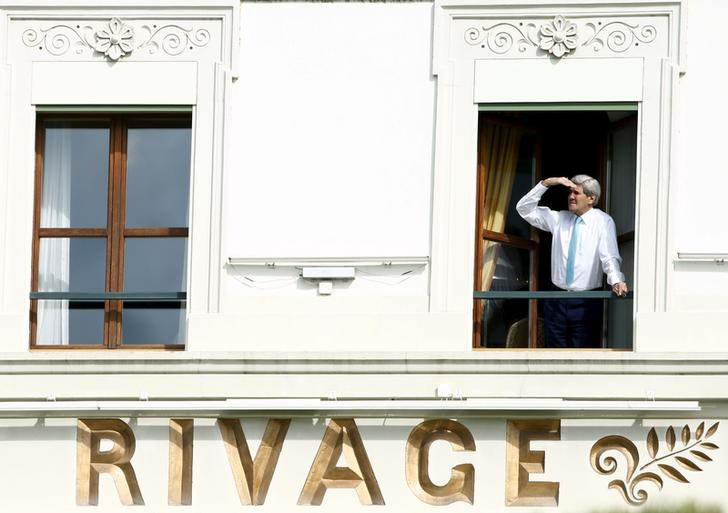 U.S. Secretary of State John Kerry looks out of his room at the Beau Rivage Palace Hotel during a break during the Iran nuclear program talks in Lausanne April 1, 2015.