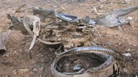 Debris is seen at the crash site of Air Algerie flight AH5017 near the northern Mali town of Gossi, July 24, 2014.