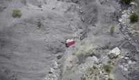 An aerial photo taken from a helicopter shows the crash site of the Germanwings Airbus A320 and its debris on the mountainside near e Seyne-les-Alpes, April 3, 2015.