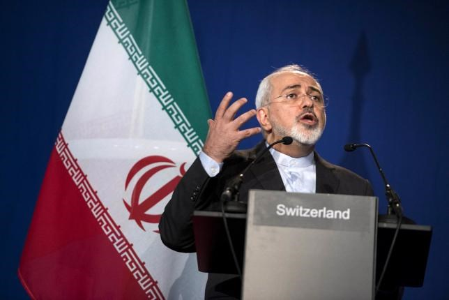 Iran's Foreign Minister Javad Zarif gestures as he speaks during a news conference at the Swiss Federal Institute of Technology in Lausanne (Ecole Polytechnique Federale De Lausanne) on April 2, 2015