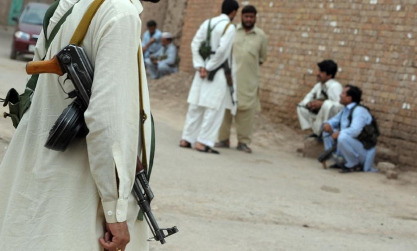 File picture shows armed Pakistani militiamen armed with Kalashnikov assault rifles gathering before a patrol on the outskirts of Peshawar, in northern Pakistan, on July 3, 2009
