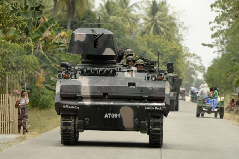 An armored personnel carrier travels along a road in rebel-infested Maguindanao Province, southern Philippines, March 31, 2015