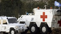 Spanish UN peacekeepers drive an armoured emergency vehicle after picking up the body of a 36-year-old Spanish UN soldier who was killed as the Israeli military shelled border areas in the Lebanese village of Abbassiyeh, January 28, 2015