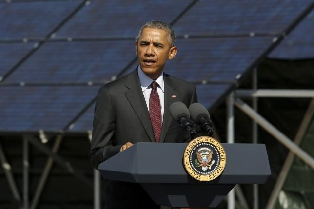 U.S. President Barack Obama delivers remarks on clean energy after a tour of a solar power array at Hill Air Force Base, Utah April 3, 2015.