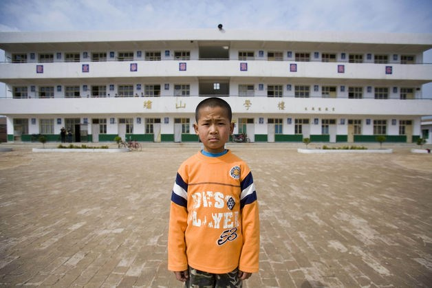 Liu Shi, whose parents have moved to Hangzhou to be migrant workers, at his school in Chunhua county in Shanxi Province, April 14, 2008.