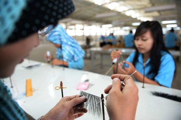 Workers arrange false eyelashes at the PT Bio Takara factory in Purwokerto, Central Java, Indonesia.