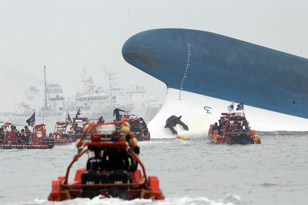 Rescue boats sail near Sewol, a 6,825-ton passenger ship owned by Chonghaejin Marine Co., 20 kilometers off of Jindo, South Korea, on April 16, 2014.