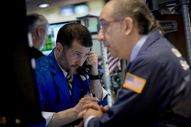 Traders work on the floor of the New York Stock Exchange April 9, 2015.