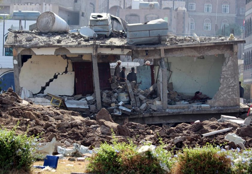 A two-storey building is seen after it was destroyed by an air strike in Yemen's central city of Ibb April 13, 2015.