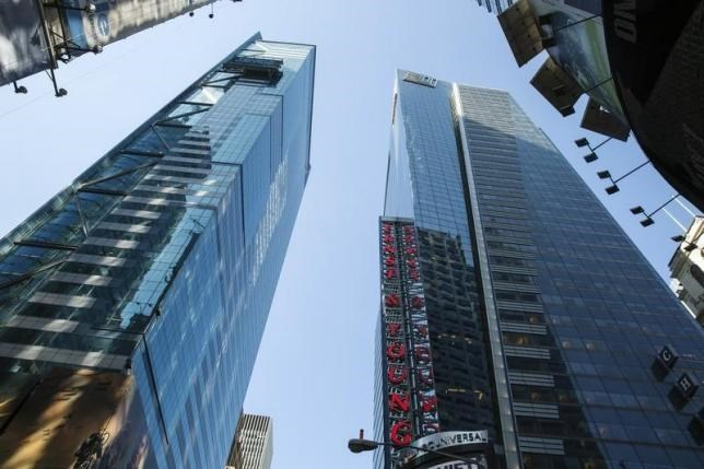 The Ernst & Young building rises above Times Square in New York June 18, 2014.