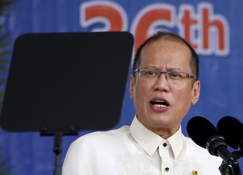 President Benigno Aquino reads his speech through a teleprompter during a graduation ceremony of police cadets at the Philippine National Police academy in Silang, Cavite south of Manila March 26, 2015.