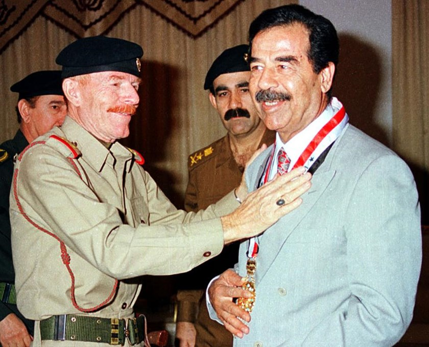 Iraq's vice-Chairman of the Revolution Command Council, Ezzat Ibrahim al-Douri, gives an award to President Saddam Hussein (R) in Baghdad in an undated file photo.