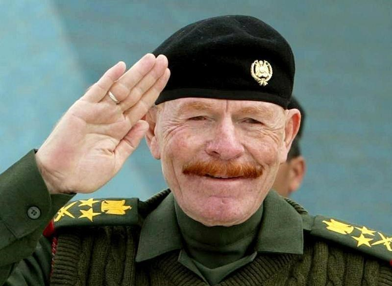 A file photograph shows Ezzat al-Douri, chairman of the ruling Revolutionary Command Council, during a military celebration in Baghdad February 16, 2003.