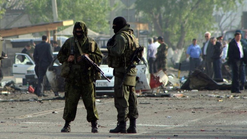 Special forces officers guard the site of two fatal blasts on May 4, 2012 in Dagestan's capital Makhachkala, part of Russia's restive Caucasus region