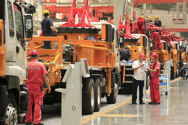 Employees work on the manufacture of construction machinery in Sany Heavy Industry Co.'s assembly shop in Changsha, Hunan Province, China.
