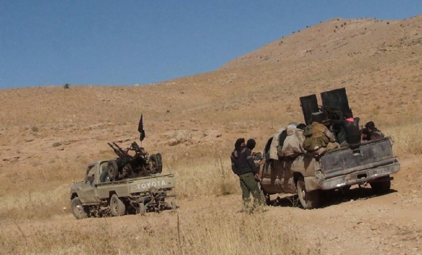 Rebel fighters gather on the Syrian side of the Qalamun hills close to the border with Lebanon