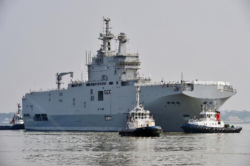 The delivery of the first of two Mistral-class warships has been suspended for six months over Russia's role in the Ukraine conflict