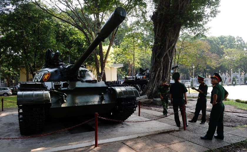 Replicas of Tank 390 (L) and Tank 843 (behind R), the first tanks credited with crashing through the gates of Saigon's presidential palace 40 years ago, on display at Ho Chi Minh City's Reunification Palace